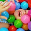 Caucasian Child Playing Ball Pool - Stock Photo