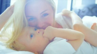 Close Up Blonde Haired Baby Girl Laughing Mother — Stock Video