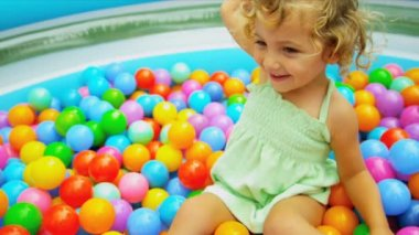 Cute Blonde Child Enjoying Ball Play — Stock Video