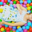 Young Child Playing Ball Filled  Pool Full Frame - Stock Photo