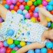 Laughing Little Girl Playing Plastic Balls — Stock Video #18891127