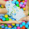 Stock Video: Little Caucasian Girl in Ball Pool Close Up