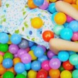 Stock Video: Close Up CaucasiChild Playing Ball Pool