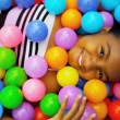 Laughing Little Ethnic Girl Playing Plastic Balls — Stock Video