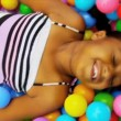 Stock Video: Little AfricAmericGirl in Ball Pool