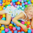 Cute Blonde Child Enjoying Ball Pool — Stock Video