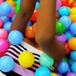 Close Up Ethnic Child Playing Ball Pool — Stock Video