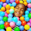 Young Ethnic Child Playing Ball Filled  Pool — Stock Video