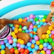 Ethnic Sisters Playing Ball Pool - Stock Photo
