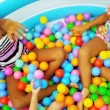 Stock Video: Sisters Childhood Fun in Garden Pool