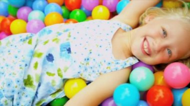 Caucasian Child Playing Ball Pool — Stock Video