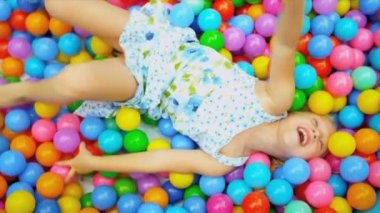 Little Caucasian Girl in Ball Pool Close Up — Stock Video