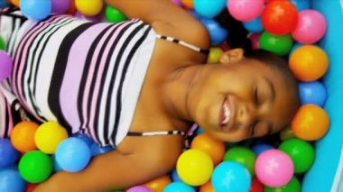 Little African American Girl in Ball Pool — Stock Video