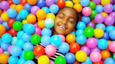 Ethnic little girl laughing in ball pool shot on RED EPIC