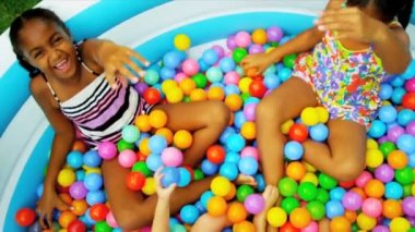 Sisters Childhood Fun in Garden Pool — Stock Video #18892775