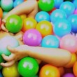 Royalty-Free Stock Векторное изображение: Cute Toddler Playing Ball Pool