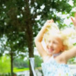 Pretty Little Blonde Girl Jumping for Joy - Foto Stock
