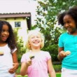 Stock Video: Cute Multi Ethnic Girls Garden Fun Races