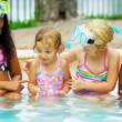 Stock Video: Laughing Little Girls Enjoying Swimming Pool
