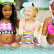 Pretty Multi Ethnic Children Playing Swimming Pool - Stock Photo