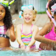 Multi Ethnic Girls Swimming Pool - Stock Photo