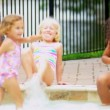 Royalty-Free Stock Векторное изображение: Young Children Enjoying Water Outdoors