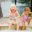 Royalty-Free Stock Векторное изображение: Pretty Multi Ethnic Children Playing Swimming Pool