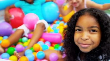 Happy Multi Ethnic Girls Ball Pool — Stock Video