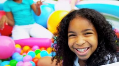 Multi ethnic little girls laughing in home garden ball pool shot on RED EPIC