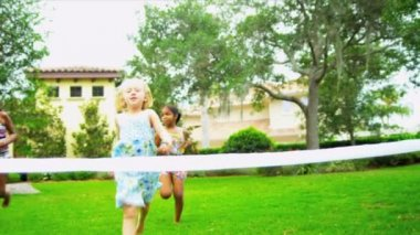 Little ethnic girls enjoying fun sports day running race in garden shot on RED EPIC