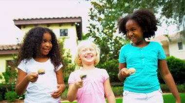 Little African American Caucasian girls taking part in fun sports events in home garden shot on RED EPIC