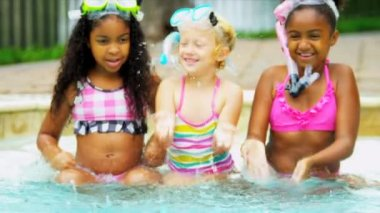 Little Caucasian African American girls enjoying healthy outdoor activity in water swimming pool shot on RED EPIC
