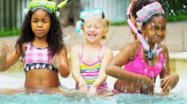 Cute young multi ethnic childhood friends playing together outdoor swimming pool shot on RED EPIC