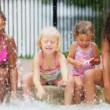 Royalty-Free Stock Векторное изображение: Laughing Little Girls Enjoying Swimming Pool