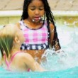Laughing Little Girls Enjoying Swimming Pool — Stock Video