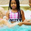 Stock Video: Pretty Multi Ethnic Children Playing Swimming Pool