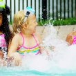 Stock Video: Laughing Multi Ethnic Girls Swimming Pool Slow Motion