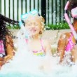 Stock Video: Young Children Enjoying Water Outdoors