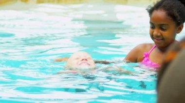 Pretty Multi Ethnic Children Playing Swimming Pool — Stock Video