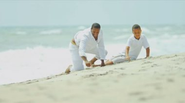Ethnic parent bonding together son on beach — Stockvideo