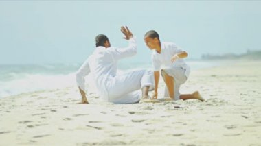 Loving ethnic father son holiday together beach — Stock Video