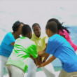 Active ethnic family celebrating together successful game on beach — Stock Video