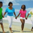 Happy ethnic parents walking and talking with sons and daughter on beach — Wideo stockowe