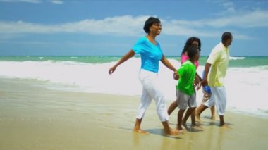 African American parents walking and chilling with children holding hands on beach — Stock Video