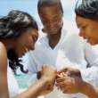 Happy African American parents with daughter enjoying beach — Vídeo de stock
