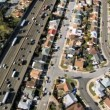 Aerial view of a congested freeway in the suburbs — Stock Video