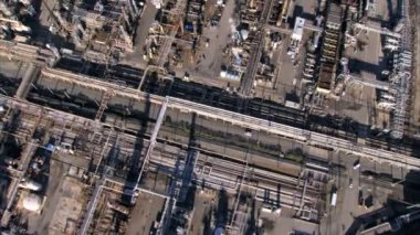 Aerial view of oil refinery tanks beside the ocean — Stock Video