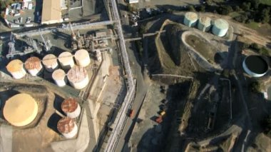 Aerial view flying over an oil refinery — Stock Video