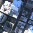 Aerial vertical view of rooftop skyscrapers within the streets — Stock Video