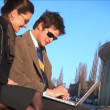Wide shot of 2 businesspeople on laptop — Stock Video #19184193